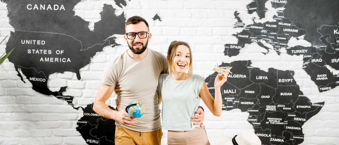Portrait,Of,A,Young,Couple,Of,Travelers,Standing,Indoors,On